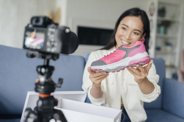 smiley woman vlogging with her sports shoes 23 2148764479